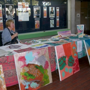 Helen Hill at the Forum desk -show and tell